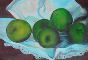 Green apple on fine towel - Abedalrahman samara