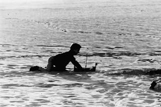 BOY PLAYING ON SAND IN VENICE - Venice 1960's