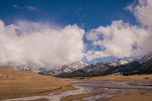 Sand dunes meet the mountains