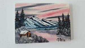 Cabin mountain scene with pink hue