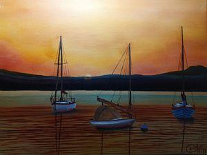 3 sailboats at sunset