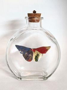 Multicolored Butterfly in a Bottle