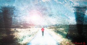 Woman walking on a road in Glen Etiv