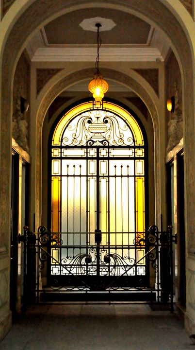 Golden stained glass entrance - Adi Starr