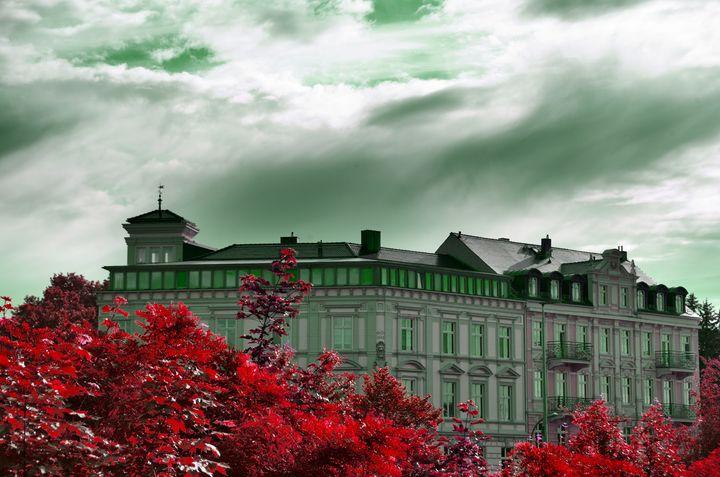 building  with  dramic  sky - EUGENE  JONAI