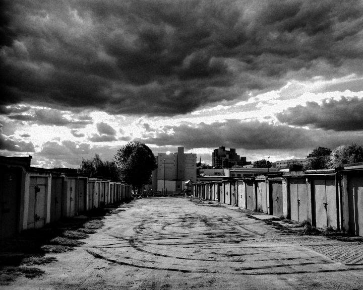garage boxes and dramatic sky - EUGENE  JONAI