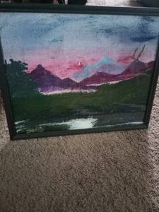 Colorful sky w/realistic mountains