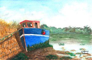 blue boat at low tide