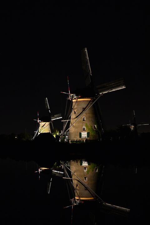 Windmills at night in water - Natarch