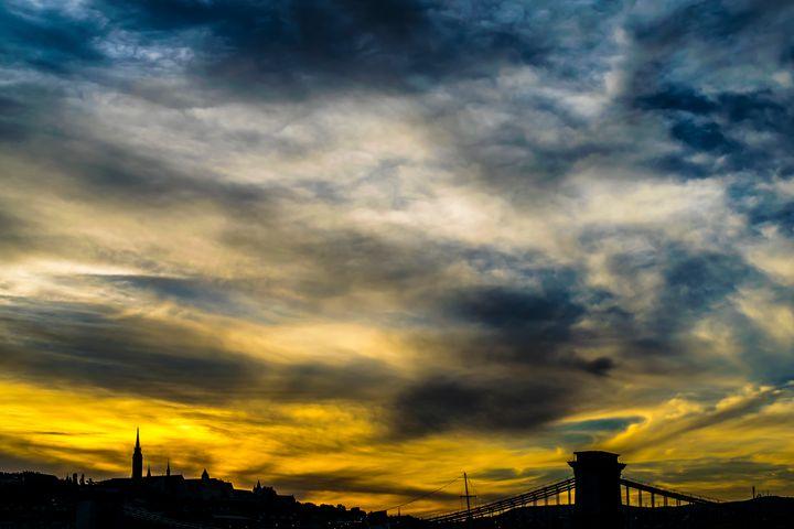 Cityscape Silhouette Under Clouds - Anita Vincze
