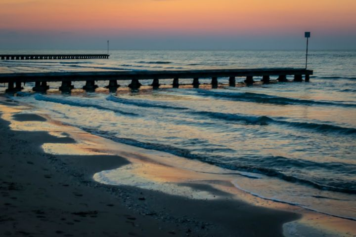 Sunrise over Piers at Sea - Anita Vincze