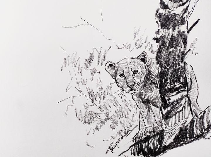 Lion cub on a tree - Puspendu Roy Karmakar
