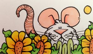 Mouse sitting in sunflowers