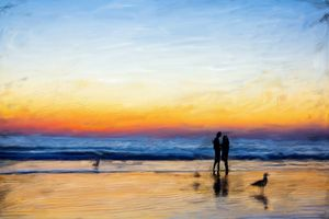 couple painting at sunset