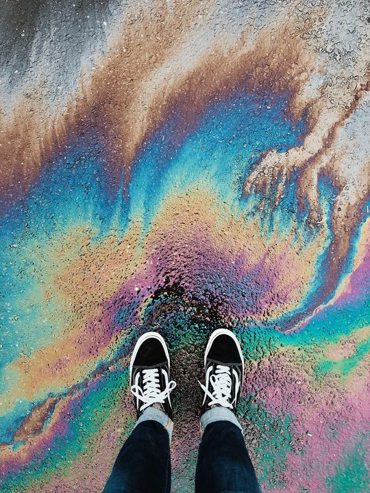 Person standing on abstract surface - Earth Gallery