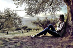 Beautiful woman sitting under a tree