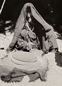 Bedouin Woman grinding wheat, Sinai