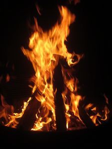 Flames Dancing Around the Campfire