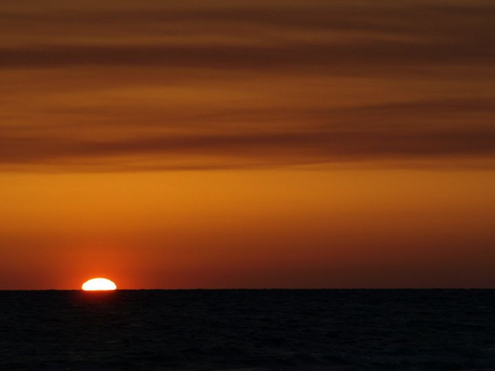 Sunsetting into the Water - JAJ Photography