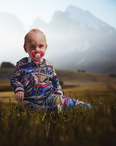 Cute Baby On Moody Grass