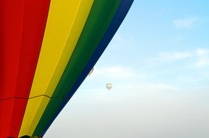 hot air balloons floating in the mor