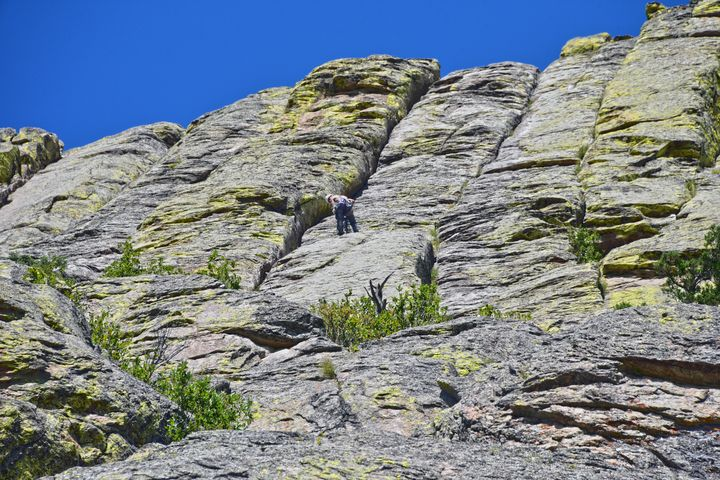 Climber Nears Summit of Devils Tower - Catherine Sherman