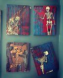 Four paintings of skeletons