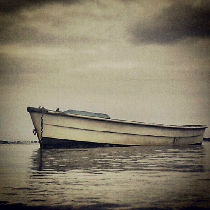 Boat on Calm Water - Dan Jones Photography