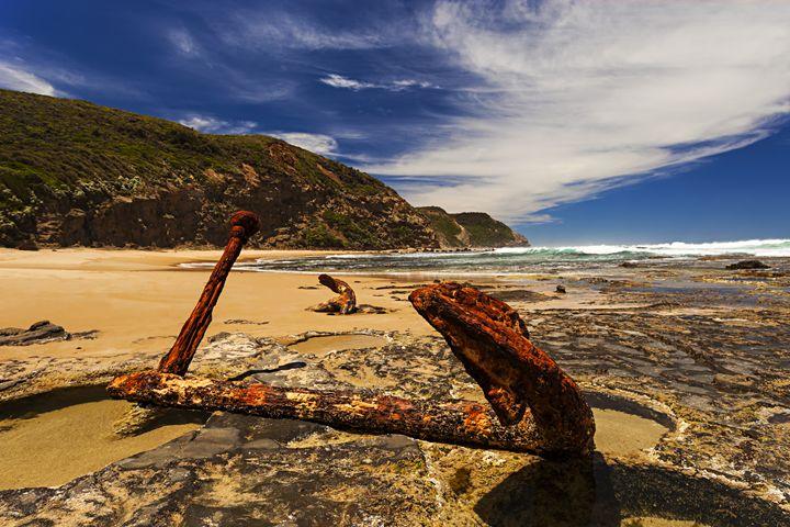 Rusty Anchor in the Rocks on the Sea - Maxwell Jordan