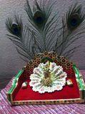 Ladoo Gopal on Red Sinhasan