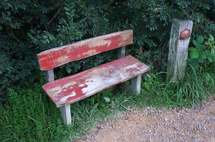 Simple red bench in the Shire - Hobbiton, Matamata, New Zealand