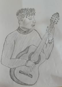 Side view of guy playing guitar