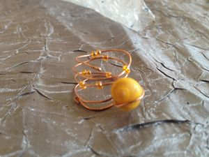 Yellow shell spiral ring