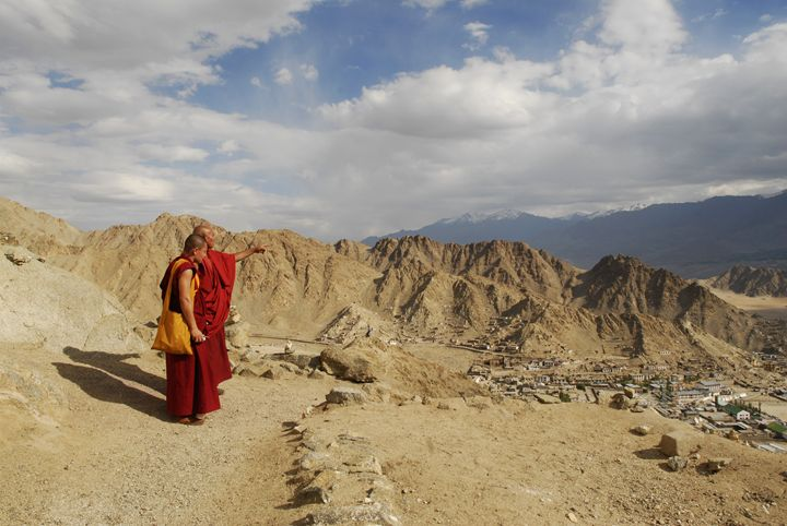 buddhist monks overlooking leh town - easywind