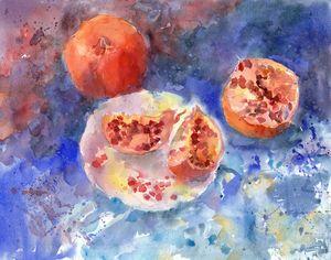 Pomegranates on a blue