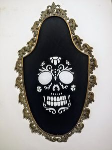 Skull on antique frame