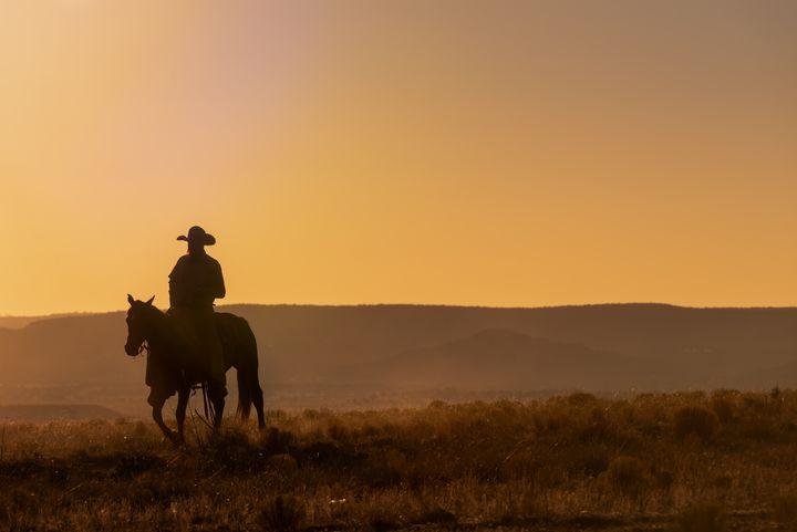 Lone Desert Cowboy Riding At Sunrise - Steve Gadomski