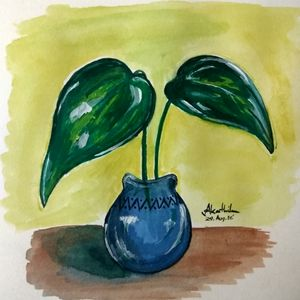 Green plan in a small vase
