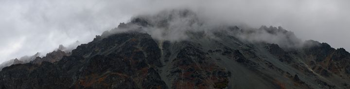Rugged Terrain Shrouded In Clouds - Adventure Images