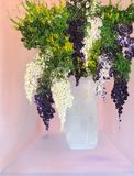 Wisteria Flowers in Sand Vase