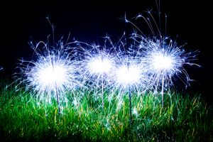 Blue sparklers in the grass