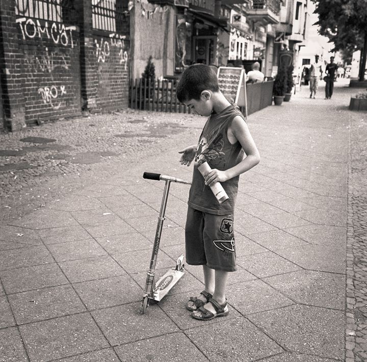 Berlin: boy with scooter - Ron Greer Photography