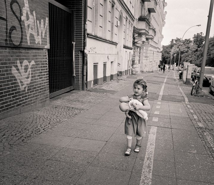 Berlin: child and doll - Ron Greer Photography