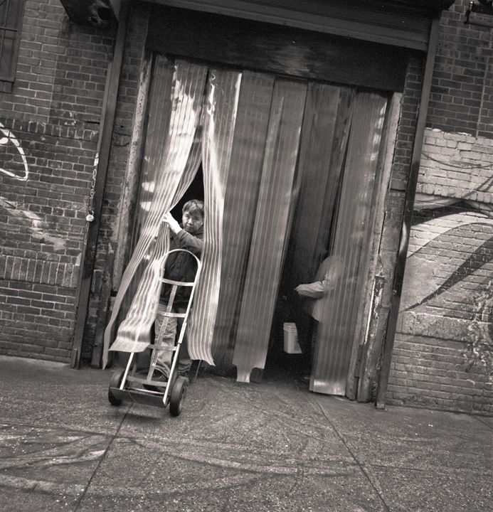 New York City: man with hand truck - Ron Greer Photography