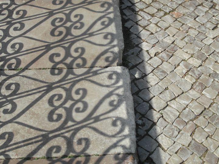 Shadow on stone path - Simon Goodwin