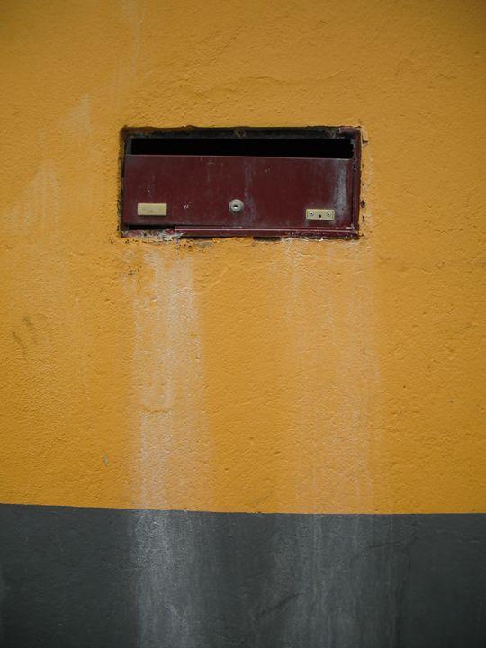 Letter box in yellow wall - Simon Goodwin