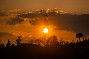 High voltage tower sunset