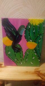 Hummingbird on a cactus