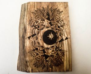 Wood burned moon mandala on oak