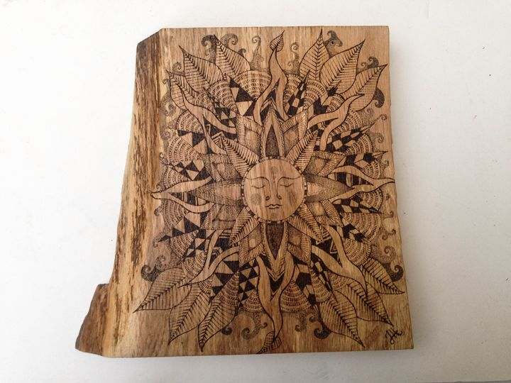 Sun mandala on oak - Jes Hooper Freehand Pyrography Art